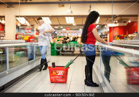 Women in shopping store shopping stock photo, Full length of women shopping in shopping in shopping store by Tyler Olson
