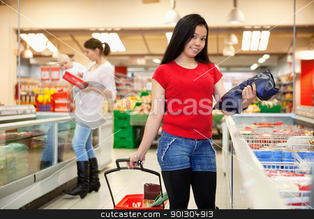 People shopping in store stock photo, Smiling woman holding bag with mother and baby in the background by Tyler Olson