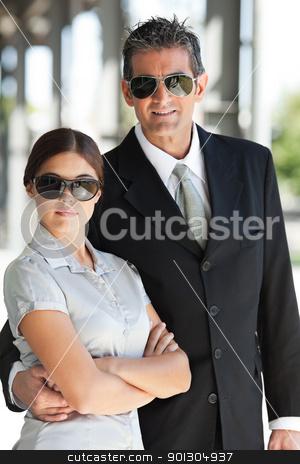 Smart business couple stock photo, Portrait of smart business couple wearing sunglasses by Tyler Olson