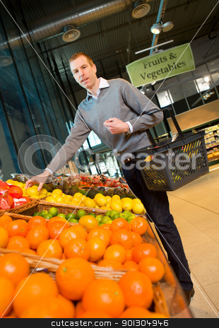 Fruits and Vegetables Grocery Store stock photo, A man buying fresh fruits and vegetables at a grocery store by Tyler Olson