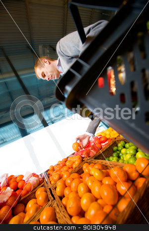 Fresh Produce stock photo, A man buying fresh fruit at a grocery store by Tyler Olson