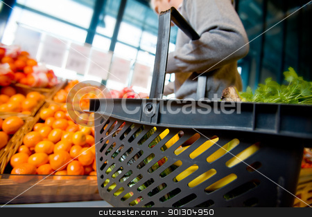 Grocery Shopping stock photo, A detail of a man shopping for fruits and vegetables by Tyler Olson