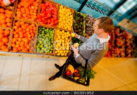 Grocery Store Fruit stock photo, A man buying fruit in a grocery store by Tyler Olson