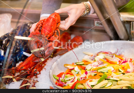 Lobster stock photo, A lobster for a sale at a fresh seafood counter in a grocery store by Tyler Olson