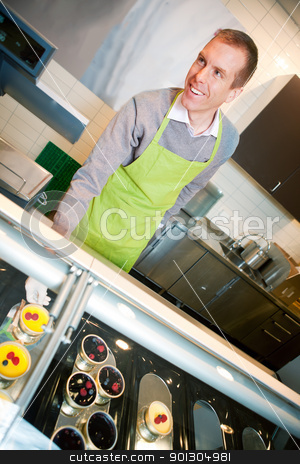 Fresh Desert Counter stock photo, A store clerk selling fresh deserts behind a glass cooler by Tyler Olson