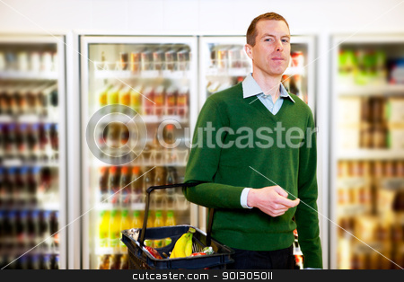 Grocery Store Man stock photo, Portrait of a man looking at the camera in a grocery store by Tyler Olson