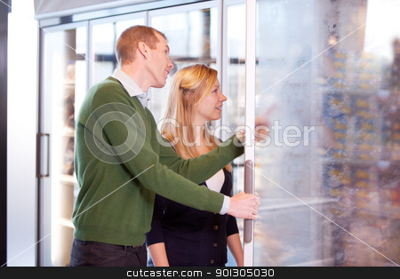 Couple in Frozen Food Section stock photo, A happy couple buying groceries in the frozen food section of a supermarket by Tyler Olson