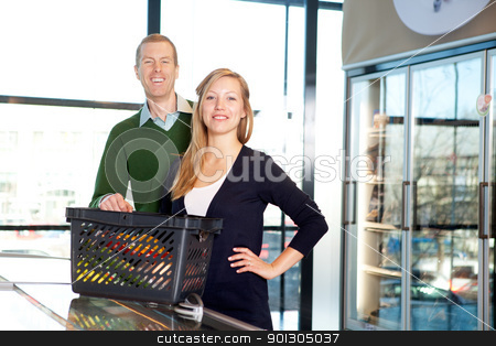 Supermarket Couple Portrait stock photo, A portrait of a happy couple in a supermarket buying groceries by Tyler Olson