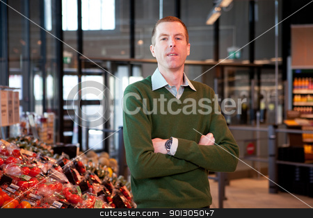 Supermarket Portrait stock photo, a portrait of a man in a supermarket by Tyler Olson