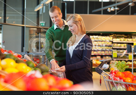 Smiling couple in shopping store stock photo, Man and woman looking at products and smiling in shopping store by Tyler Olson
