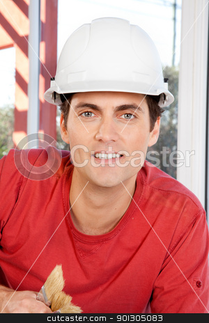 Construction Worker Portrait stock photo, Portrait of a construction worker with paint brushes and white hard hat by Tyler Olson