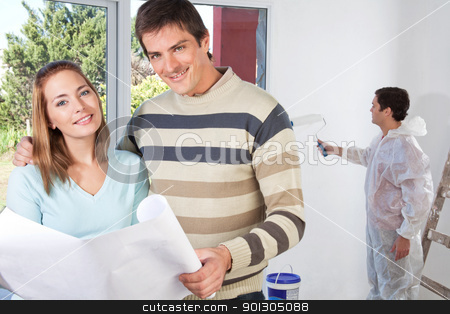 Portrait of happy couple together stock photo, Portrait of happy couple together while painter painting the wall by Tyler Olson