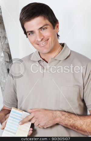 Portrait of young man stock photo, Portrait of a young man showing color guide by Tyler Olson