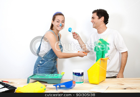 Couple playing with couple stock photo, Cheerful couple doing mischief with paint by Tyler Olson