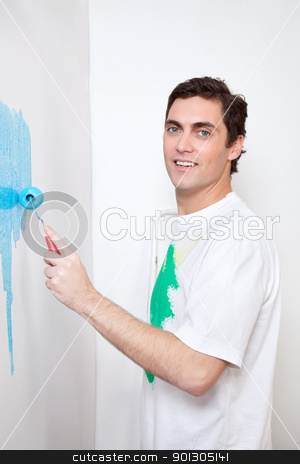 Man painting house stock photo, Portrait of smiling man painting his house with roller by Tyler Olson
