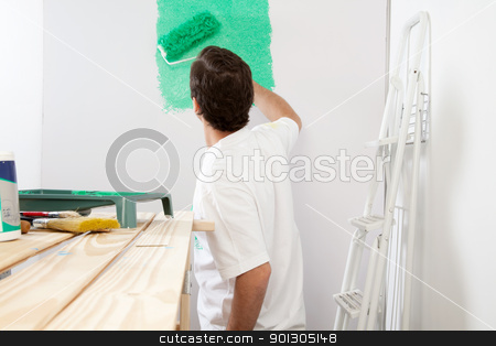 Man painting the wall with roller stock photo, Man painting the wall with roller and brush, stepladder in background by Tyler Olson