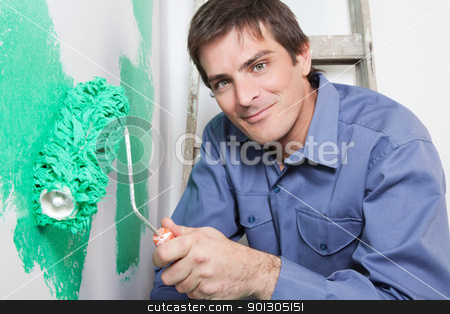 Mature man painting the wall with a roller stock photo, Portrait of happy mature man painting the wall with a roller by Tyler Olson