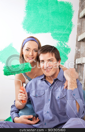 Home Improvement Couple stock photo, Portrait of smiling young couple with paint roller by Tyler Olson