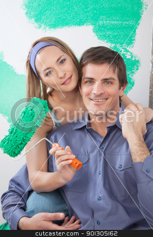 Pretty woman with arm around her boyfriend stock photo, Portrait of happy mature couple looking at camera and smiling by Tyler Olson