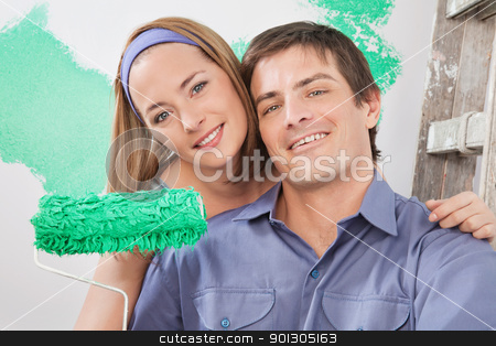 Painting Couple stock photo, Close-up portrait of young smiling couple with paint roller by Tyler Olson