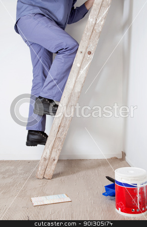 Cropped image of an workman stock photo, Cropped image of an workman climbing ladder at an apartment by Tyler Olson
