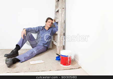 Exhausted Home Repair Man stock photo, Tired young man leaning on ladder and sleeping by Tyler Olson