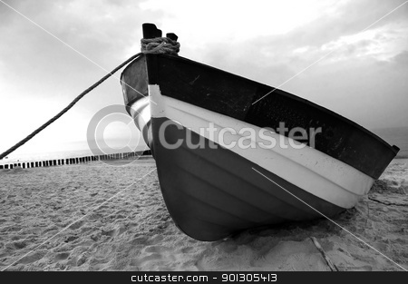 Fishboat on a beach stock photo, Old fishboat on sandy beach. Beautiful sunset - Baltic Sea in Poland  by johnnychaos
