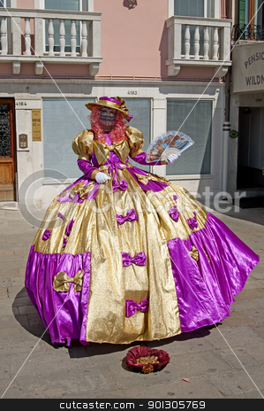 VENICE, ITALY - APRIL 10, 2011, Woman in costume. stock photo, VENICE, ITALY - APRIL 10, 2011, unidentified masked person in traditional venetian costume. by johnnychaos