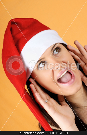 Santa Claus girl shouting stock photo, Beautiful 18 years old Santa Claus girl shouting over a yellow background by Massimiliano Pieraccini