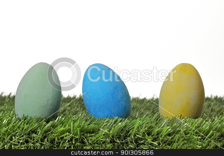 Easter Eggs on Grass stock photo, Three Easter eggs on grass on white background. by Danny Hooks