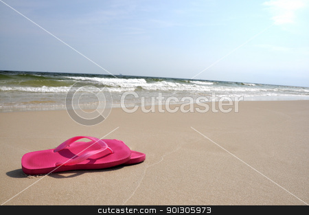 Flip Flops on Beach stock photo, Pair of flip flops on beach with copy space. by Danny Hooks