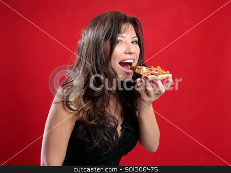 Happy woman eating pizza stock photo, A beautiful happy woman eating a slice of tasty italian pizza.  by Leah-Anne Thompson