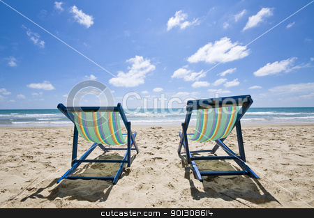 Sunbeds on the beach stock photo, Two sunbeds on the beach with blue sky, Thailand by johnnychaos
