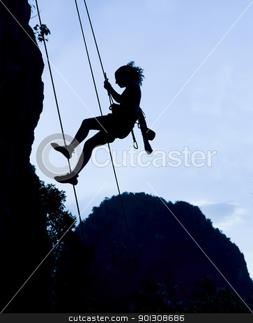 Climbing woman silhouette stock photo, Silhouette of climbing woman in Railey, Thailand by johnnychaos