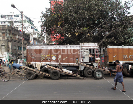 Trucks and carts wait for customers stock photo, KOLKATA, INDIA -JANUARY 25: Streets of Kolkata. Trucks and carts wait for customers to transport their cargo, January 25, 2009. by Zvonimir Atletic