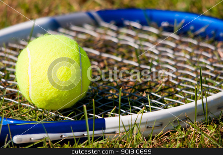 Tennis Ball and Racquet stock photo, Tenis ball and racquet on grass by ruigsantos
