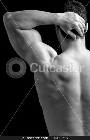 Shoulder Pain stock photo, Bodybuilder suffering from shoulder pain. by ruigsantos