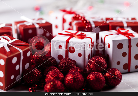 Gifts stock photo, Photography of baubles and gift connected with Christmas time and Christmas tree. by Sebastian Duda