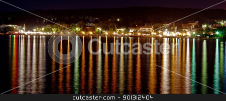 Malinska night - reflections on the Sea stock photo, Light reflecting on sea surface, Malinska, Island of Krk, Croatia by xbrchx