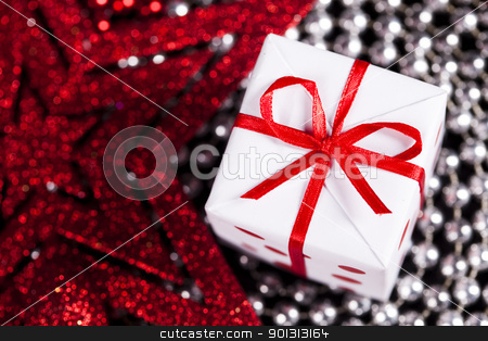 Christmas star and gift stock photo, Photography of baubles and gift connected with Christmas time and Christmas tree. by Sebastian Duda