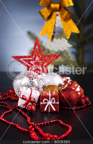 Cut spruce and Christmas balls  stock photo, Photography of baubles and gift connected with Christmas time and Christmas tree. by Sebastian Duda