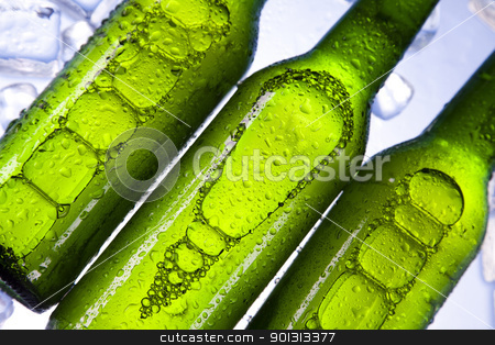 Three fresh beers with ice  stock photo, Beer collection, glass in studio. by Sebastian Duda