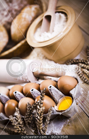 Loaf of bread over background stock photo, Still-life assortment of baked bread. by Sebastian Duda