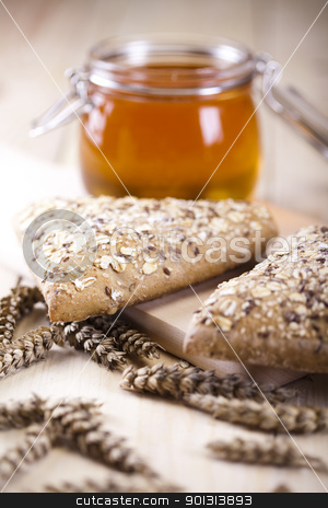 Variety of whole wheat bread stock photo, Still-life assortment of baked bread. by Sebastian Duda