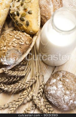 Variety of whole wheat bread stock photo, Still-life assortment of baked bread. by Sebastian Duda