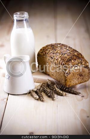 Loaf of bread over background stock photo, Still-life assortment of breakfast. by Sebastian Duda