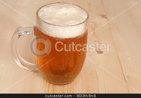 Glass of Beer stock photo, Glass Full of Beer on Wooden Table  by JAMDesign