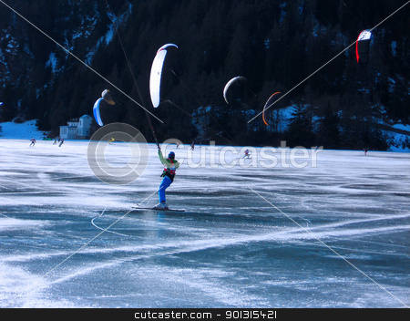 kitesurf stock photo, Snowkiting on a frozen lake - winter extreme sport in Trentino Italy by freeteo