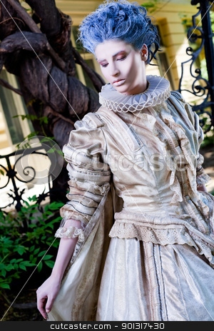 female medieval dress stock photo, Young medieval female with dress and blue wig, looking down by vilevi