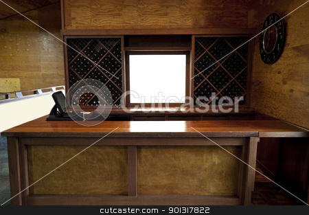 Wooden Bar stock photo, A empty wooden bar with wine bottles in the back by Kevin Tietz